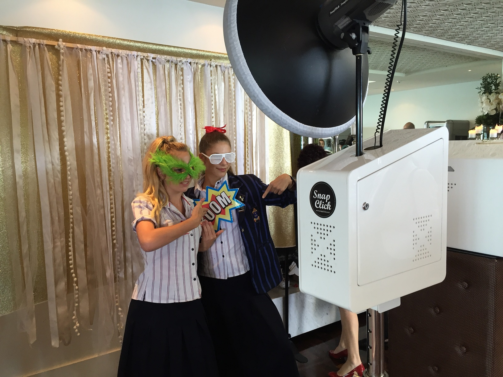 High school students enjoy the event photo booth.