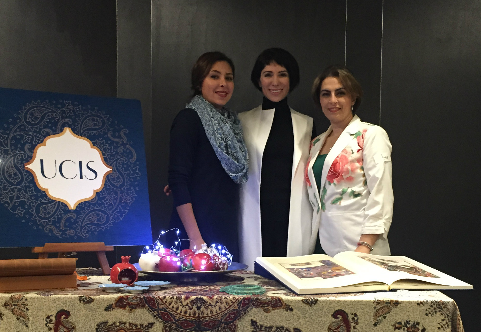 The University of Canterbury Iranian Society (UCIS) executive members at the traditional Yalda celebration. From left to right: Negar Ghrahshir, Donna Miles and Parisa Soleimani Tadi.