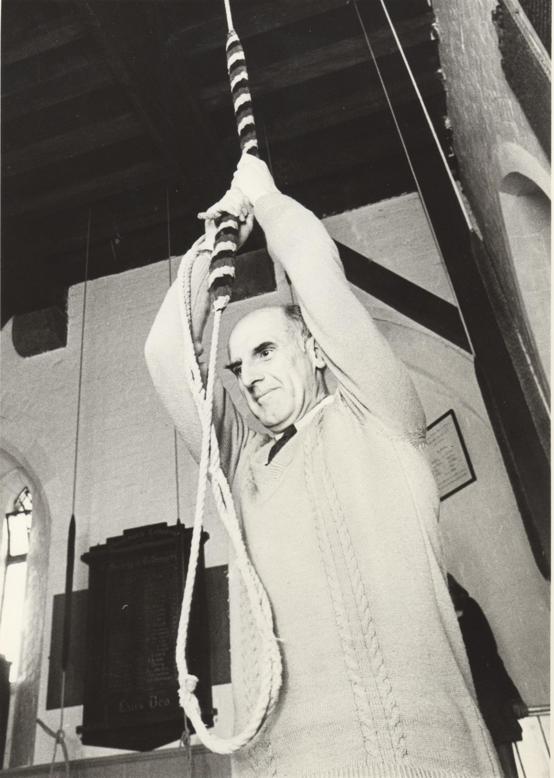 image shows Bob Bennett pulling the rope to ring the bell at the Christchurch Cathedral 1980.